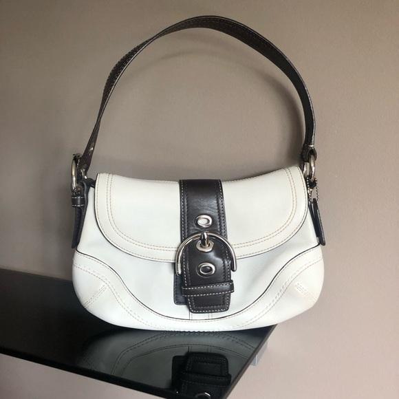 Small handbag saddlebag flap over white leather